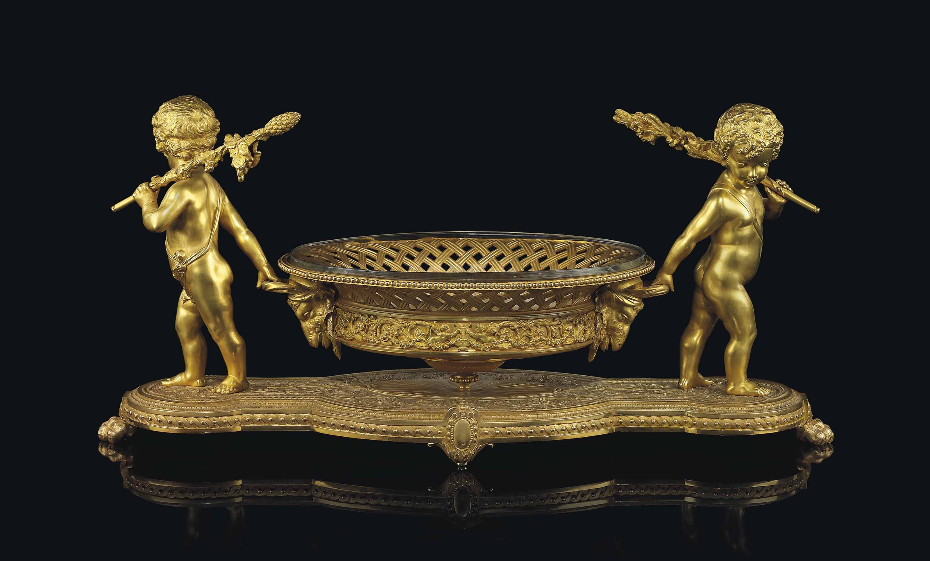 A FRENCH ORMOLU AND CUT-GLASS CENTREPIECE
