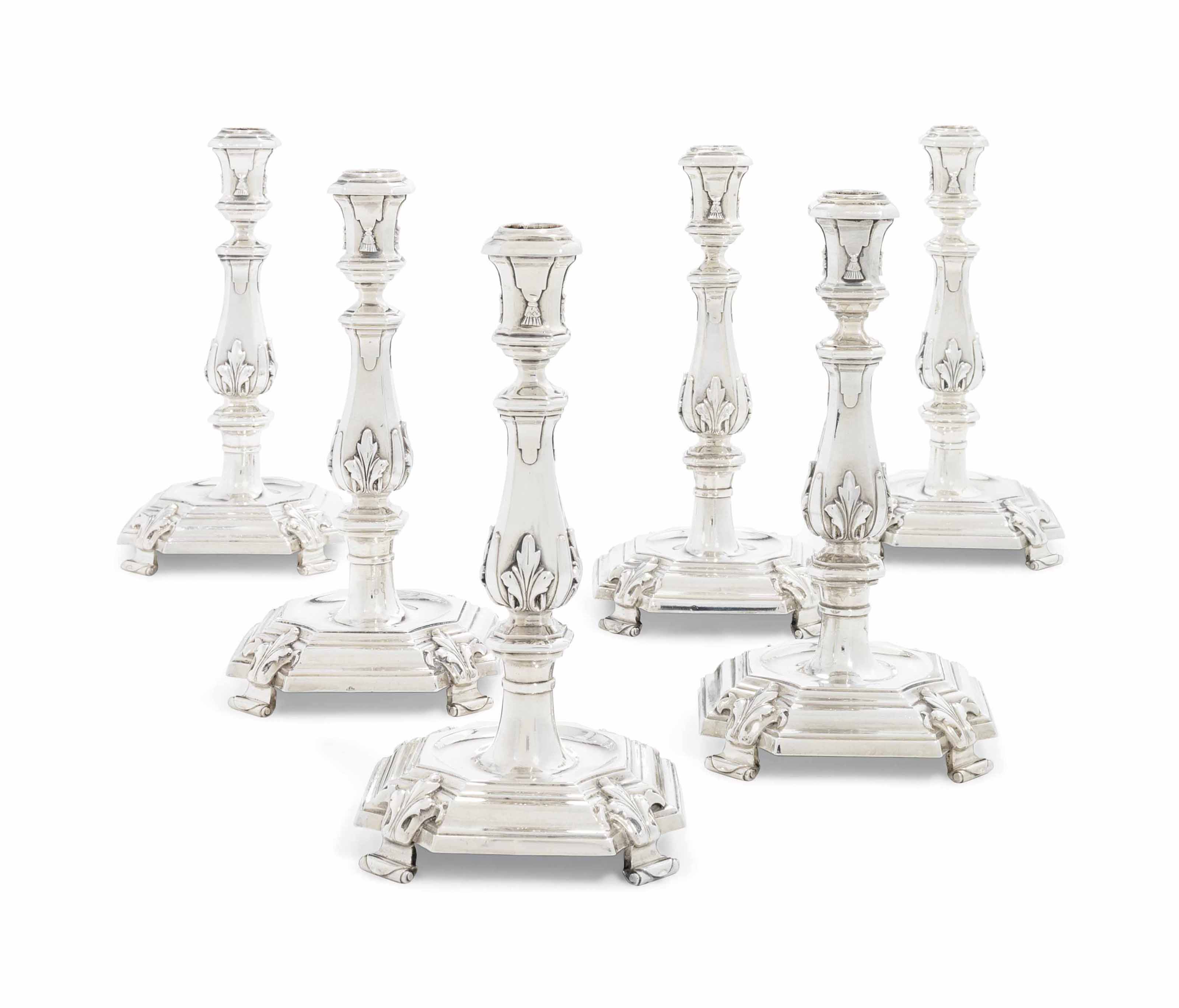 A SET OF FOUR DUTCH SILVER CANDLESTICKS AND A PAIR TO MATCH
