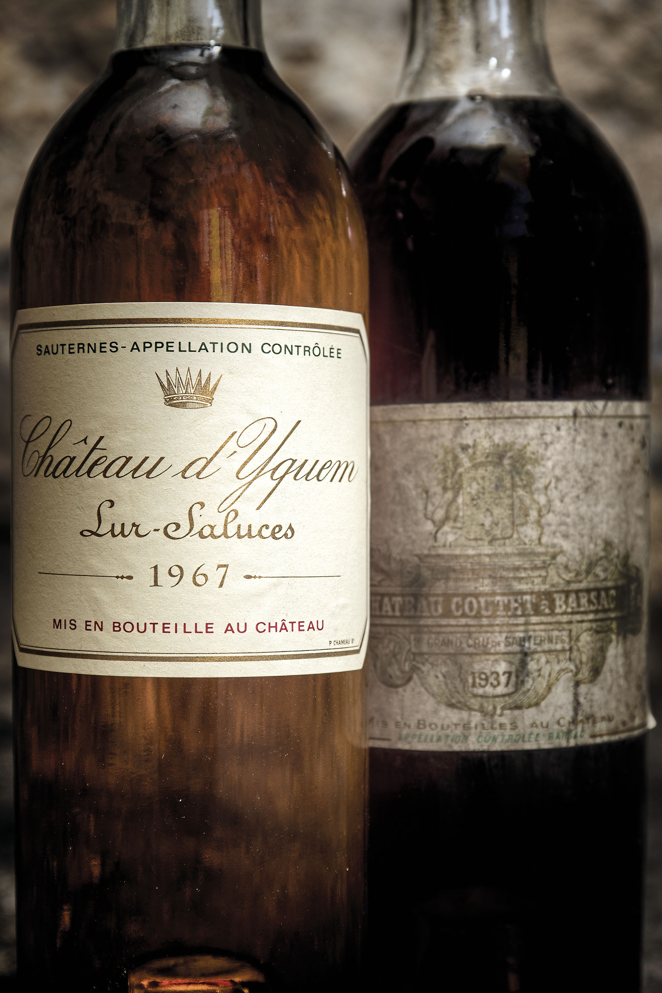 Château Coutet 1937 One remains of capsule, one corroded. Badly bin-soiled label. One vintage hand-written on label. Levels: one top-shoulder, one low-shoulder.  (2) Château Olivier Blanc 1943 French-bottled. Corroded capsules, one with signs of seepage.. Bin-soiled, slightly damaged labels. Levels: six top-shoulder and one low-shoulder with dark colour  (7) Château d'Yquem 1967 Original tissue. Corroded capsule. Good appearance. Level: base of neck  (1)