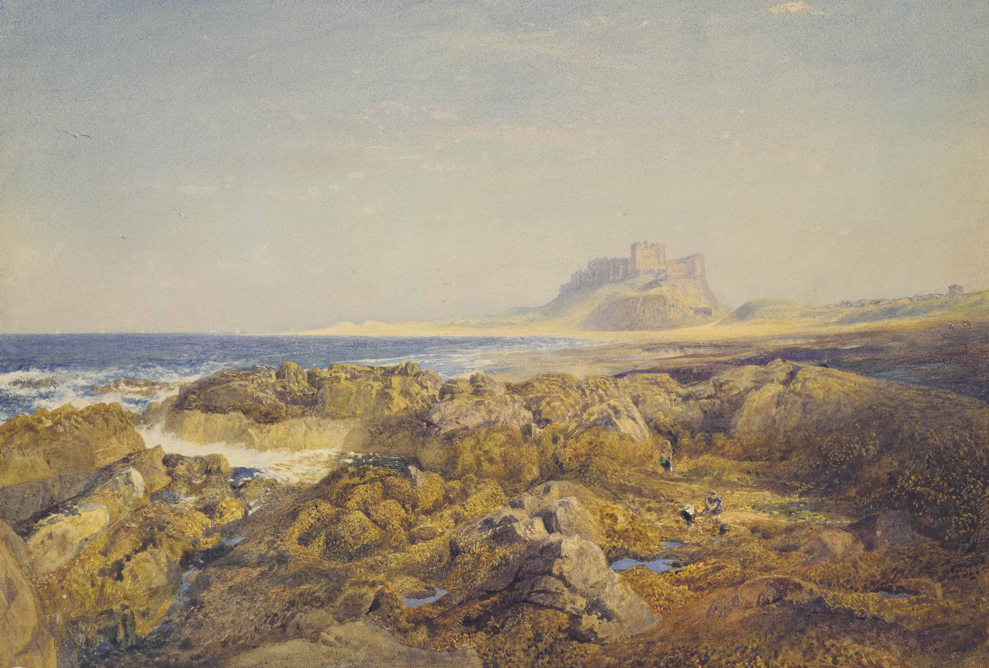 Bamburgh Castle at low tide