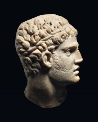 A ROMAN MARBLE RELIEF HEAD OF