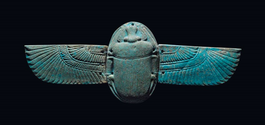 AN EGYPTIAN BLUE FAIENCE WINGE