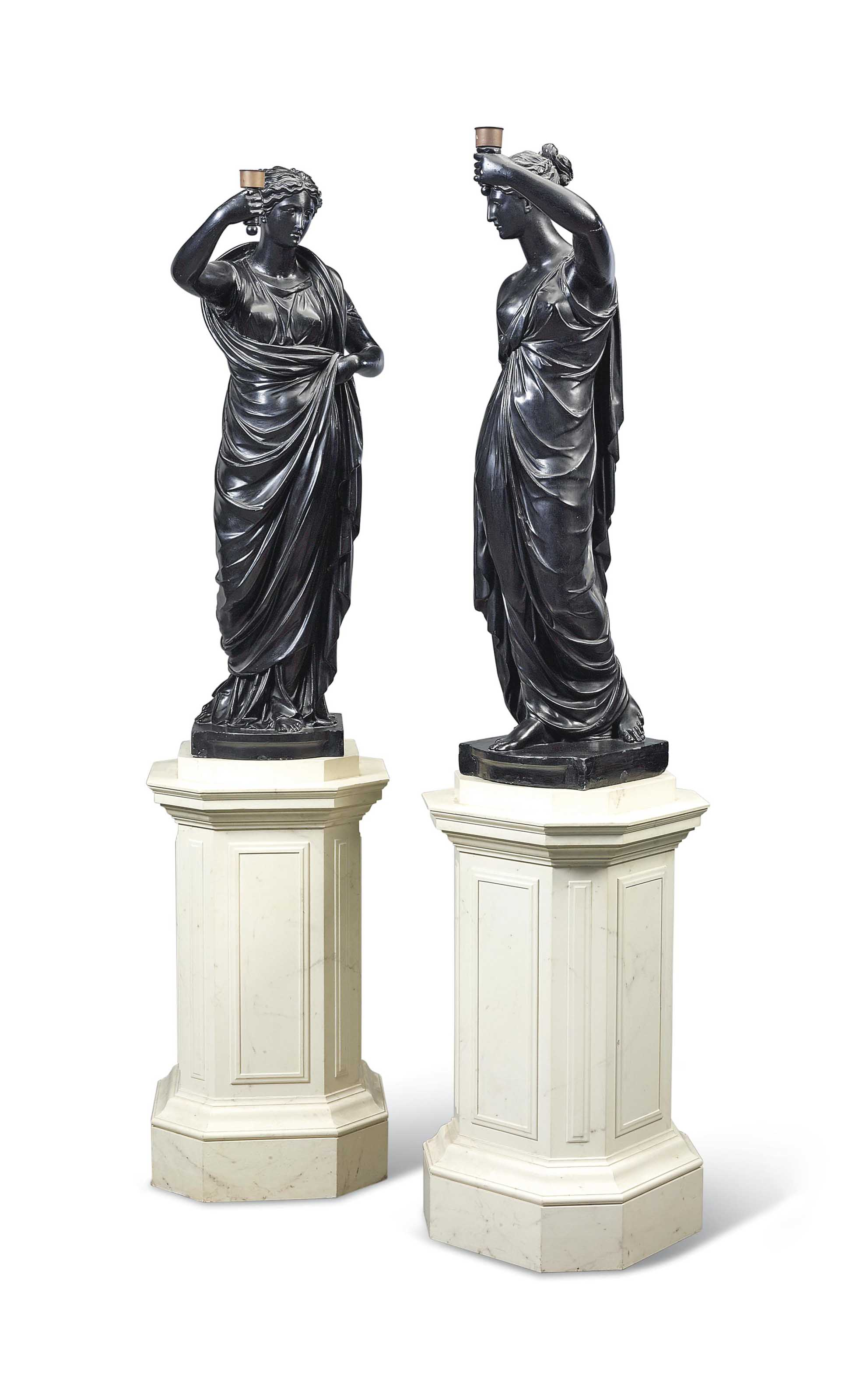 A PAIR OF PATINATED PLASTER FIGURES OF TORCH-BEARING VESTALS