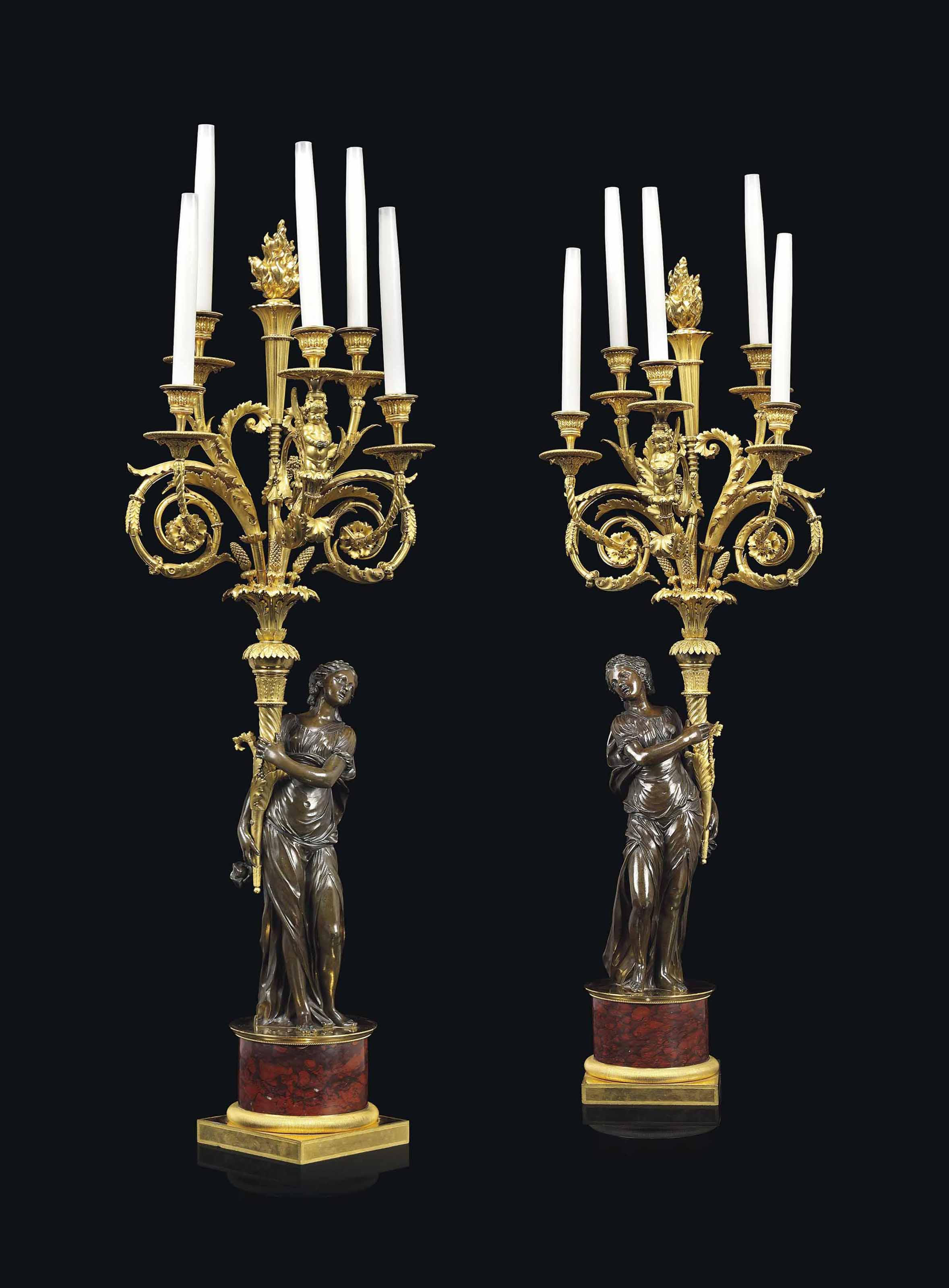 A PAIR OF LOUIS XVI PATINATED-BRONZE AND ORMOLU FIVE-LIGHT CANDELABRA