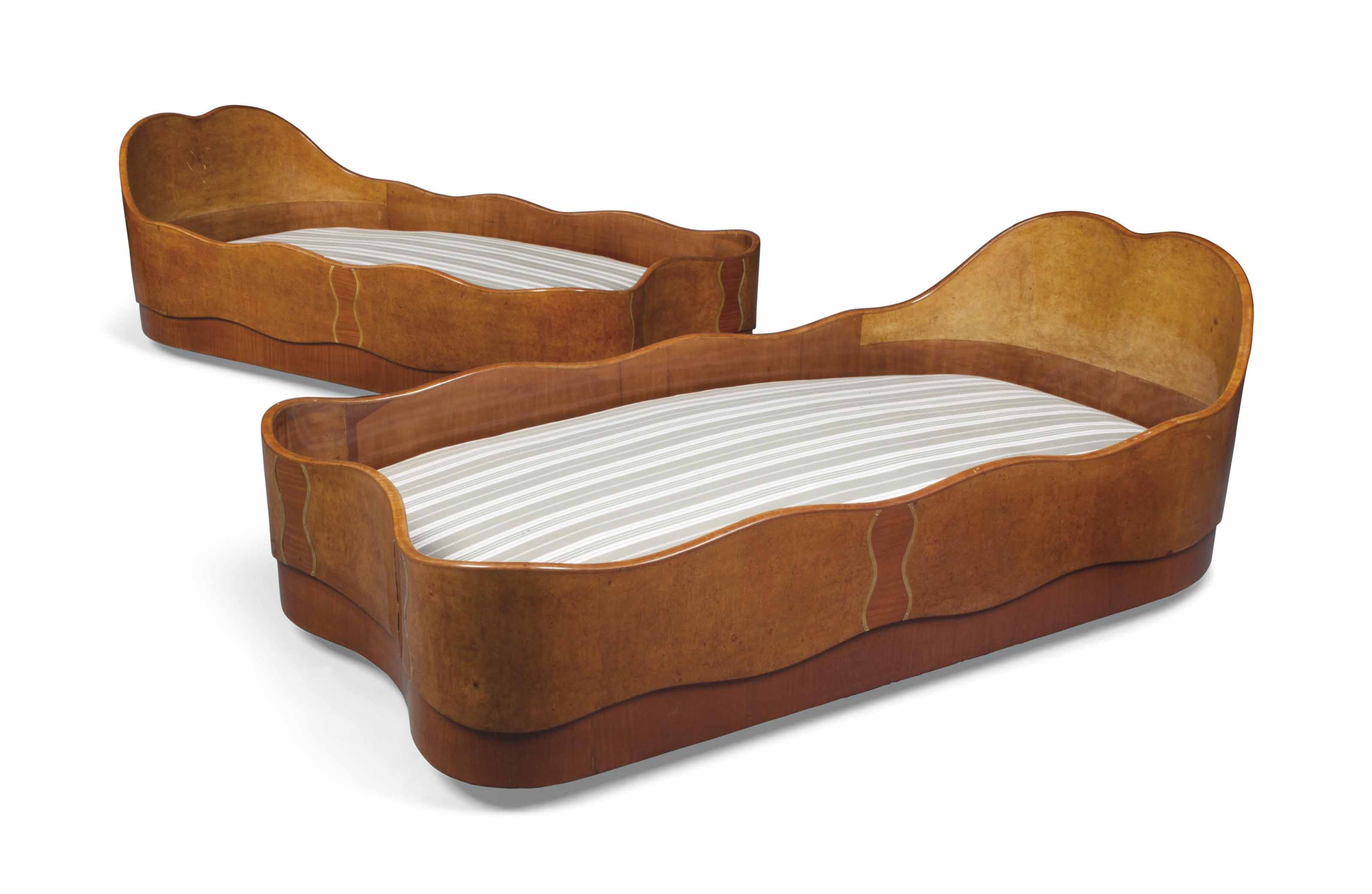 A PAIR OF MAURICE DUFRENE (1976-1955) CHERRY AND BURR WALNUT SINGLE BEDS