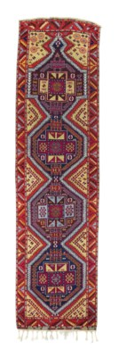 AN ANTIQUE ANATOLIAN LONG RUG,