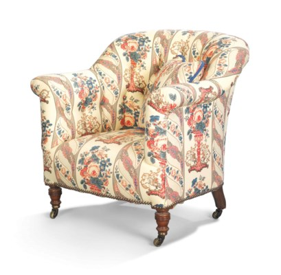 A BUTTONED TUB ARMCHAIR