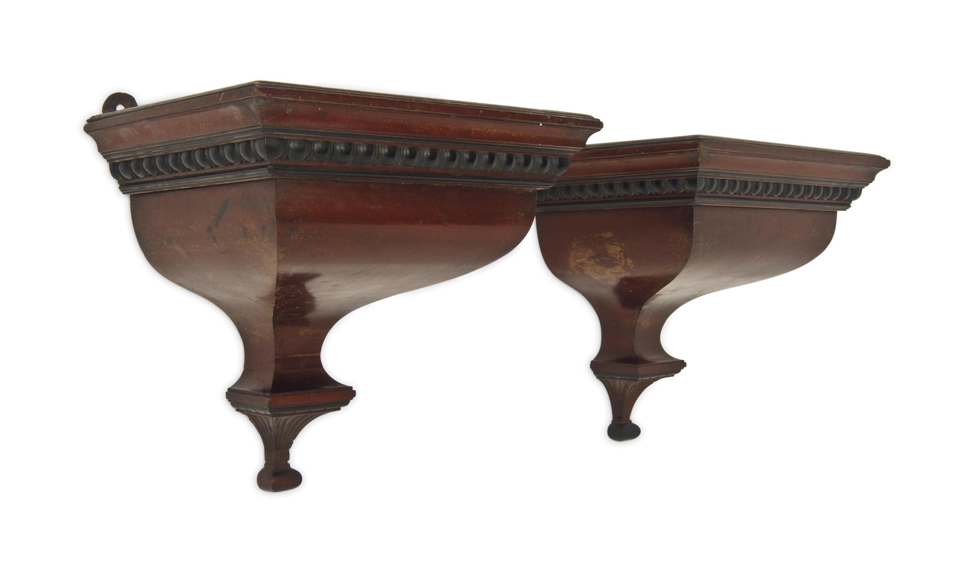a pair of mahogany wall bracke