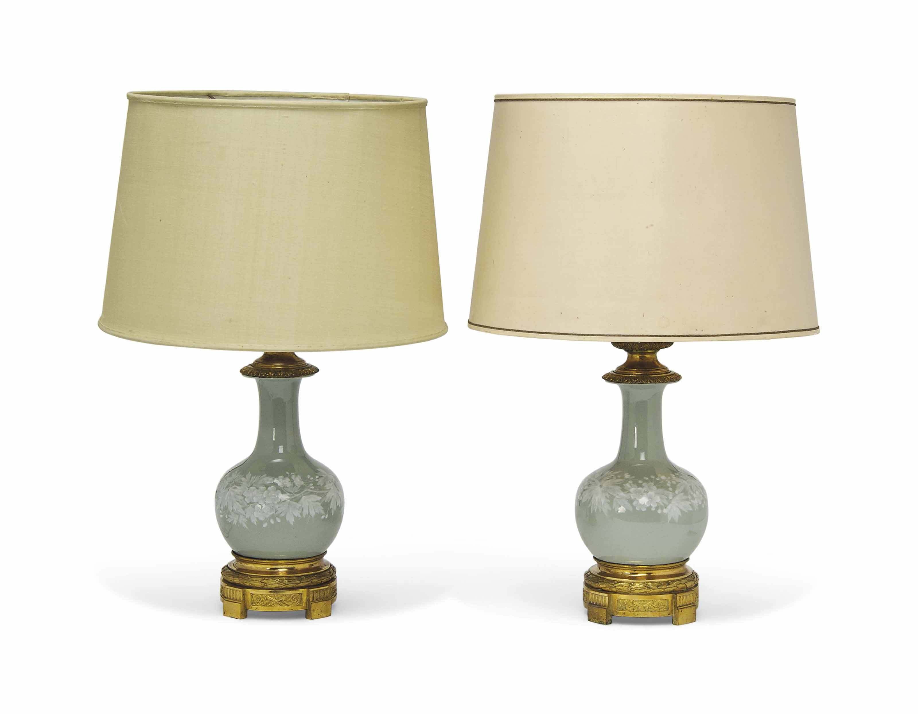 A PAIR OF FRENCH GILT-METAL MOUNTED PATE-SUR-PATE CELADON PORCELAIN TABLE LAMPS