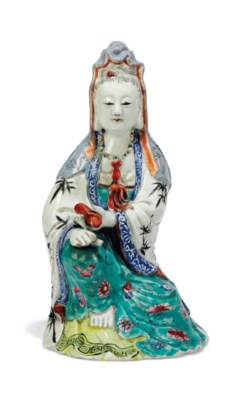A CHINESE FAMILLE ROSE SEATED