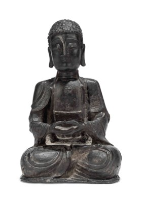 A CHINESE IRON FIGURE OF BUDDH