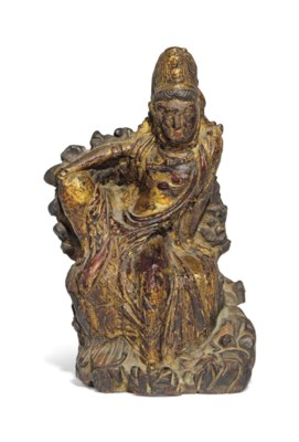 A GILT LACQUERED STONE FIGURE