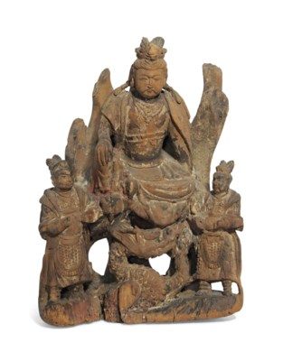 A CARVED WOOD FIGURE OF GUANYI