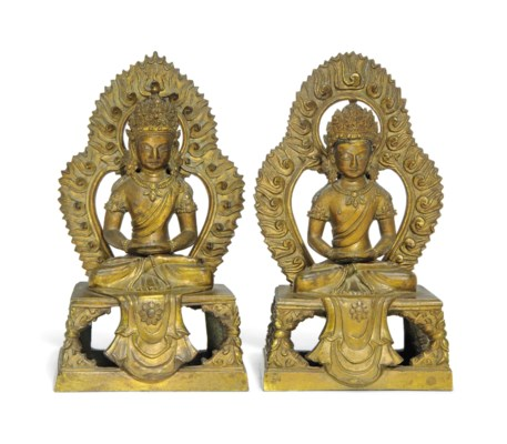 A PAIR OF GILT-BRONZE SEATED F