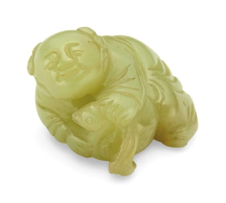 A YELLOW JADE 'BOY' CARVING