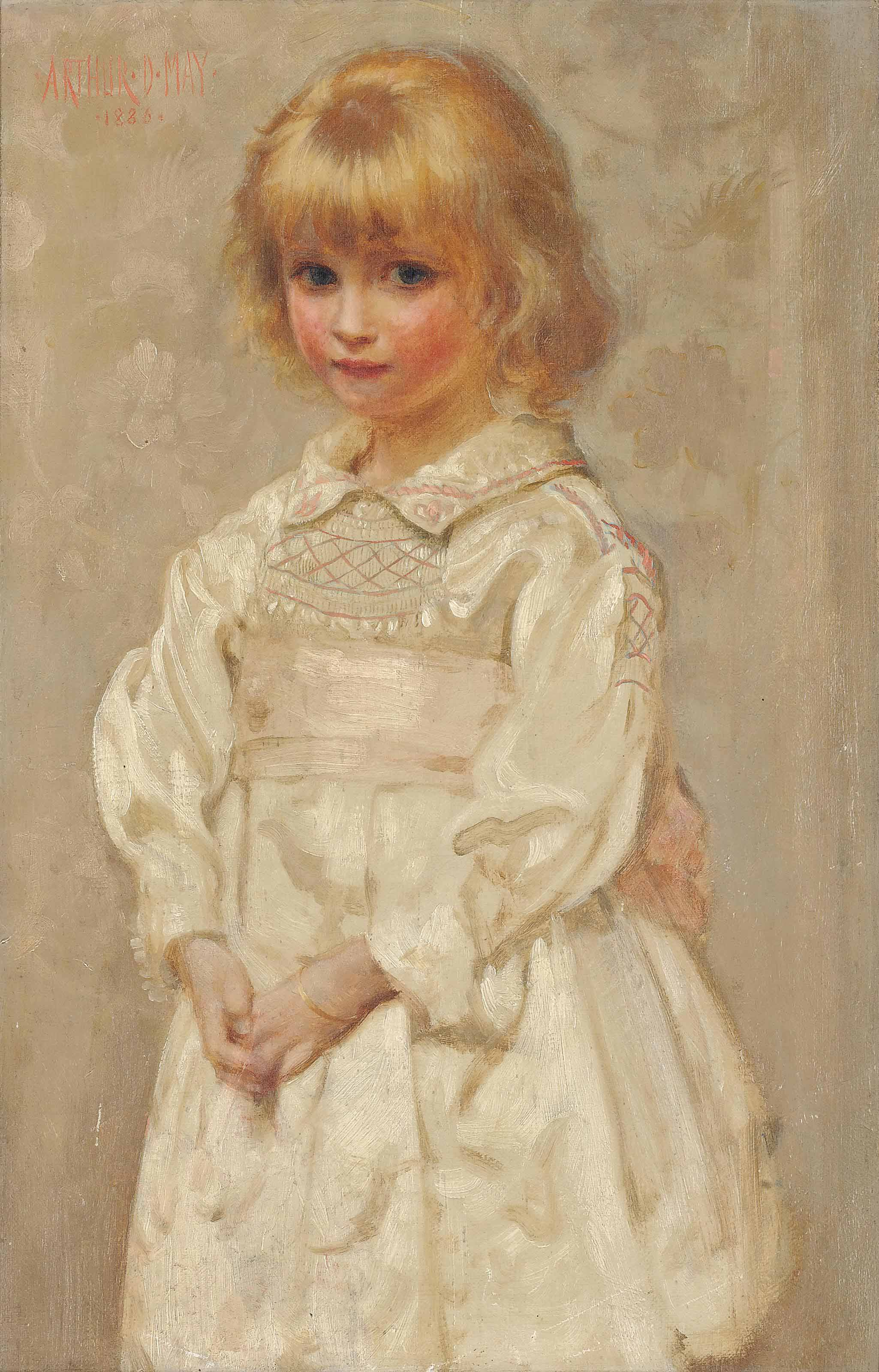 Portrait of a young girl in a pink and white smock dress