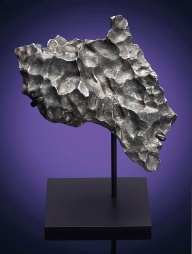 NWA 859 (Taza) meteorite — natural sculpture from outer space, iron–ung (ungrouped), vicinity of Taza, Morocco (precise coordinates unknown). 210 x 121 x 137 mm (8¼ x 4¾ x 5⅓ in). Sold for £15,000 on 20 April 2016  at Christie's in London, South Kensington