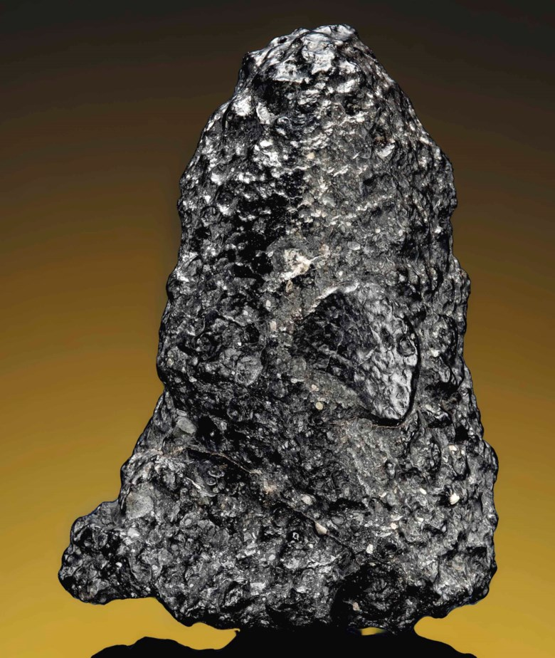 Martian meteorite NWA 7034 'Black Beauty', Martian, basaltic, breccia. Morocco. 45 x 35 x16 mm (1¾ x 1½ x⅔ in). Sold for £43,750 on 20 April 2016  at Christie's in London, South Kensington