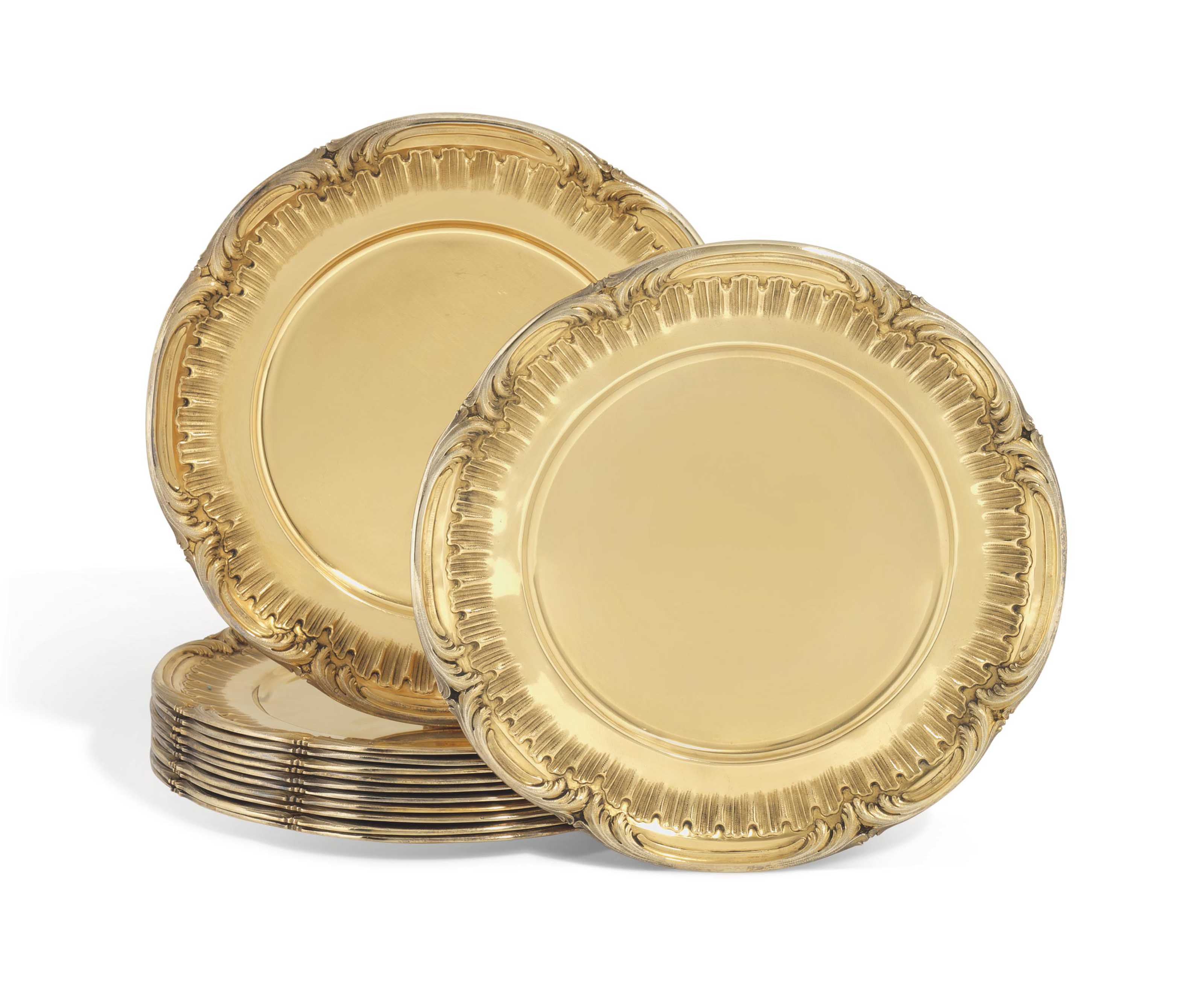 A FRENCH SET OF TWELVE SILVER-GILT UNDER-PLATES