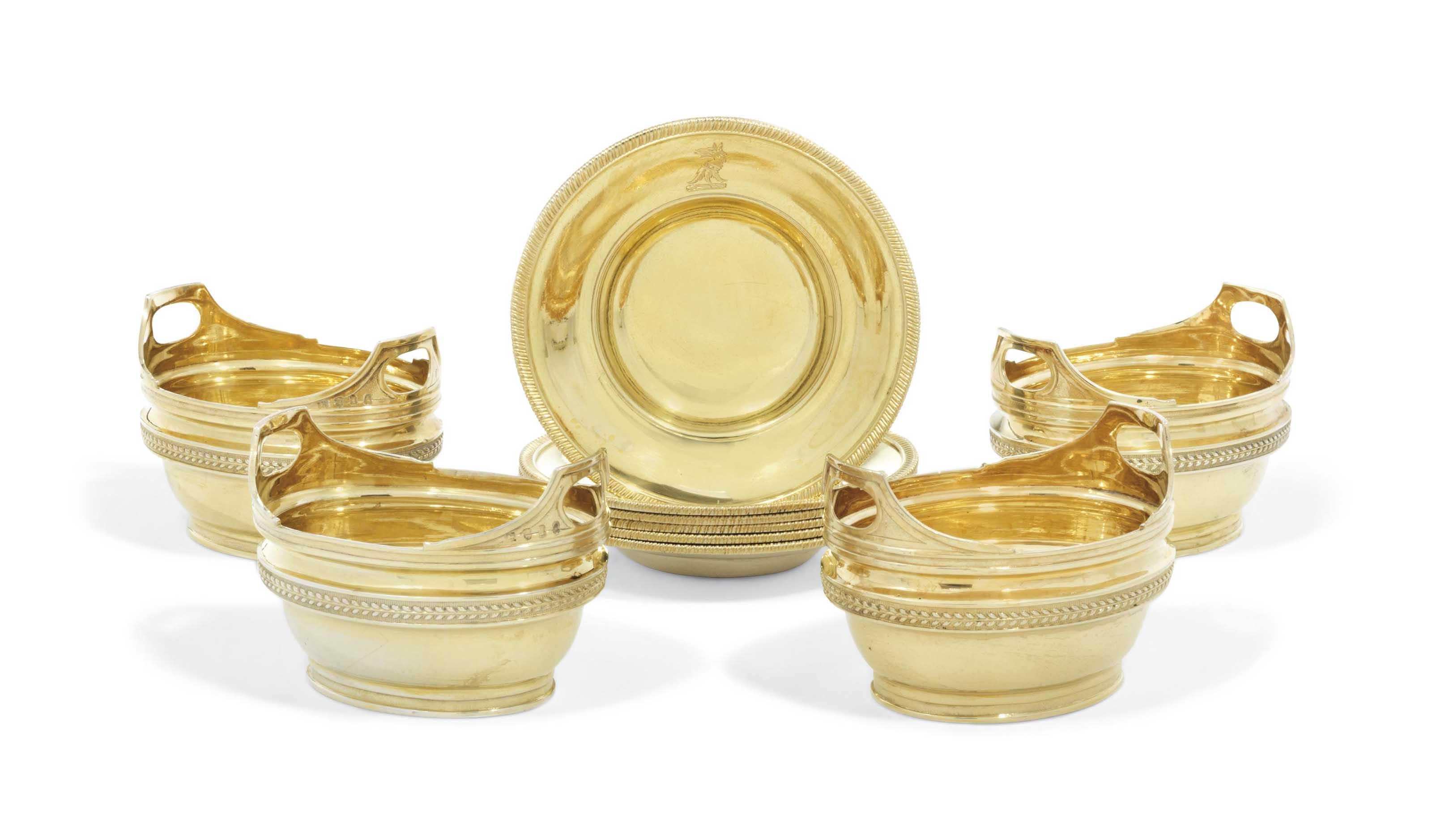 A SET OF FOUR GEORGE III SILVER-GILT SALT CELLARS AND SIX STANDS