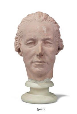 A PLASTER TINTED LIFE MASK OF