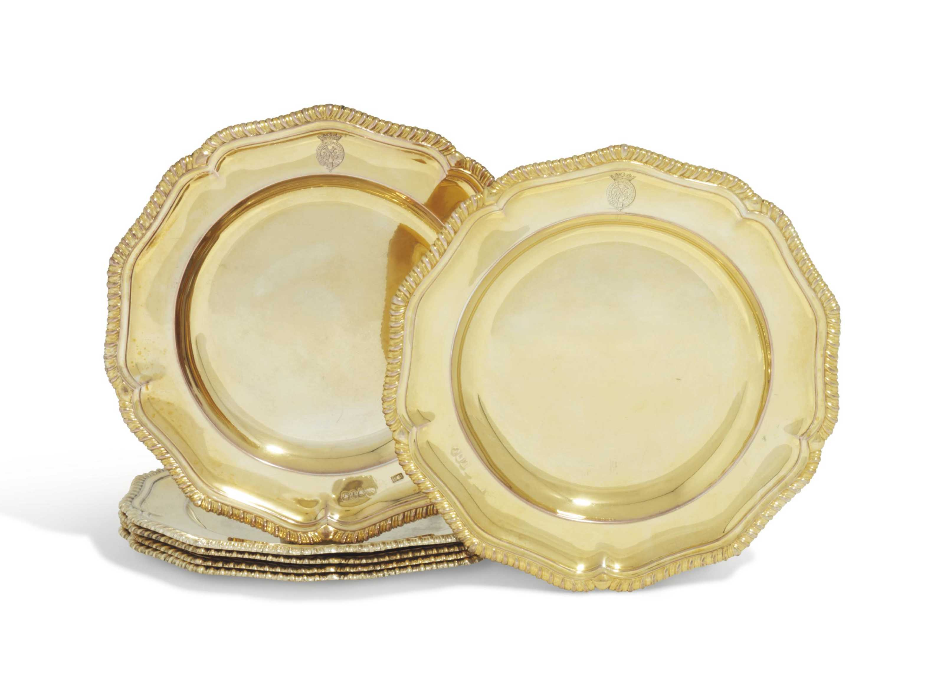 A SET OF SIX VICTORIAN SILVER-GILT DESSERT PLATES