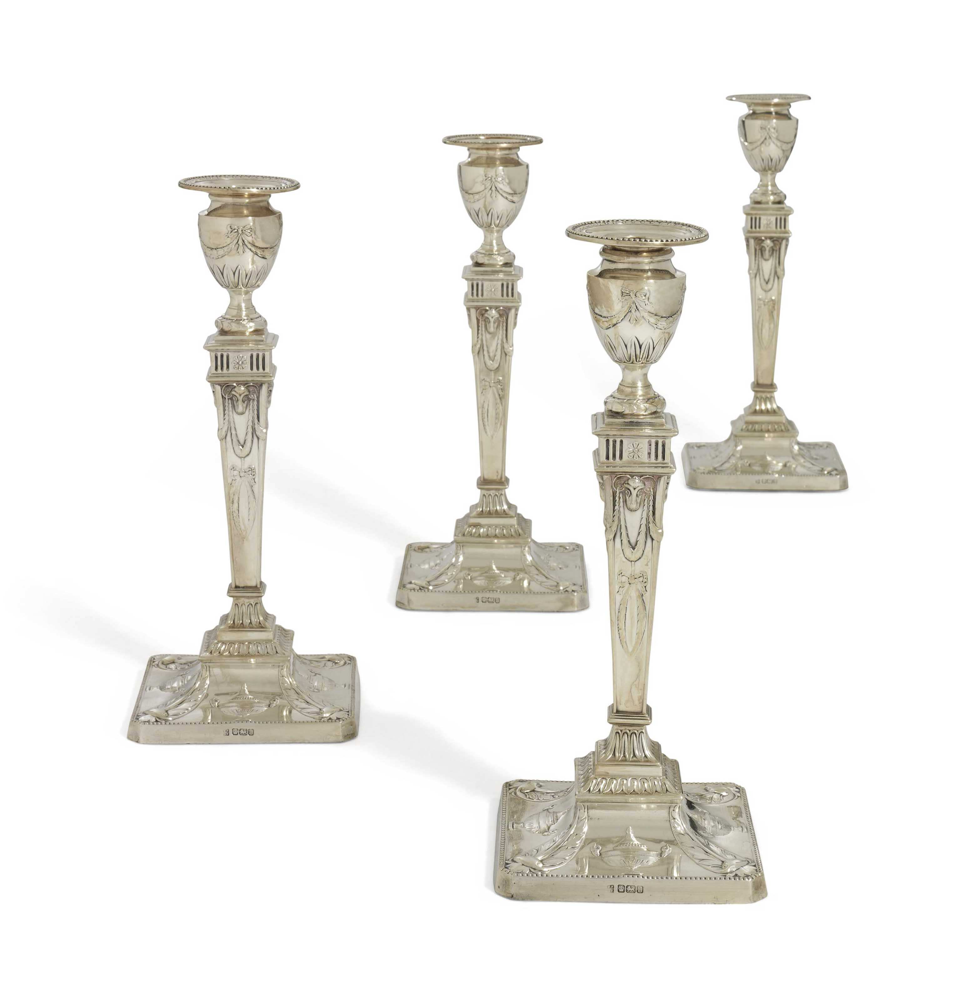 A SET OF FOUR EDWARD VII SILVER CANDLESTICKS