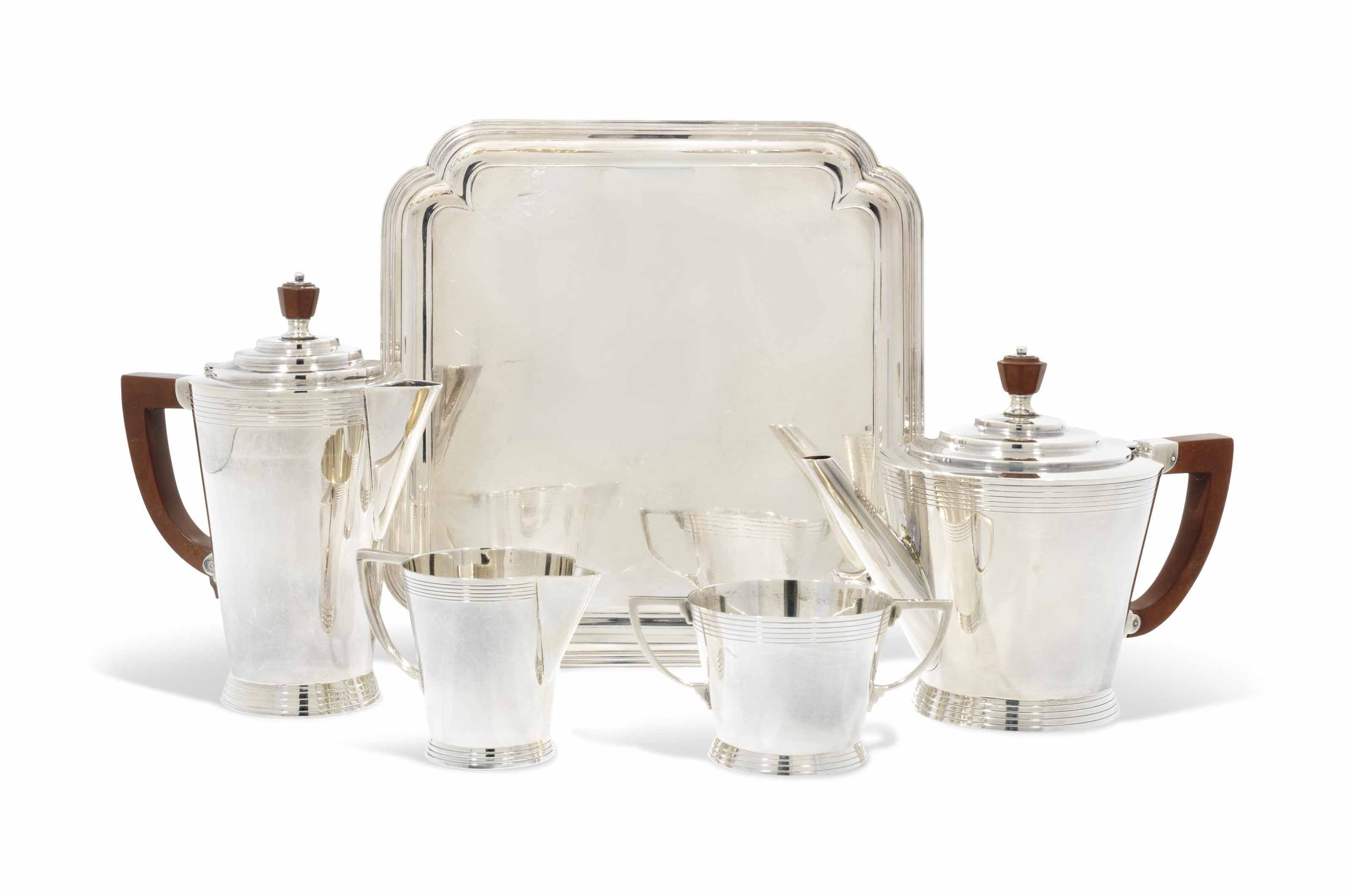 A GEORGE V FOUR-PIECE SILVER TEA AND COFFEE SERVICE