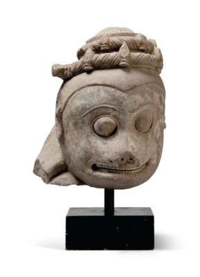 A LARGE SANDSTONE HEAD OF THE