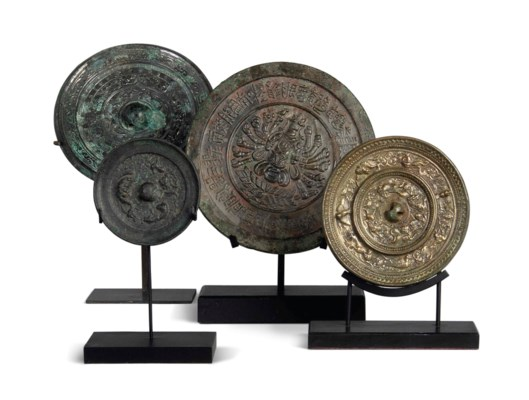 FOUR TANG-STYLE BRONZE MIRRORS