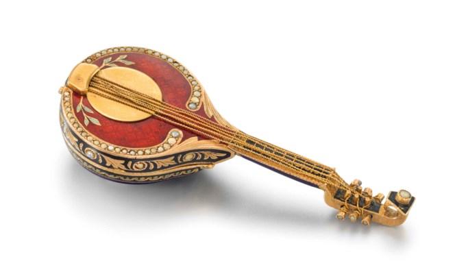 Swiss. A fine 18K gold, enamel