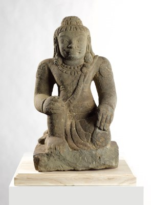 A STONE FIGURE OF DVARAPALA