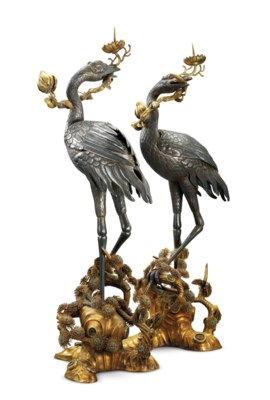 A PAIR OF SILVER CRANE CANDLES