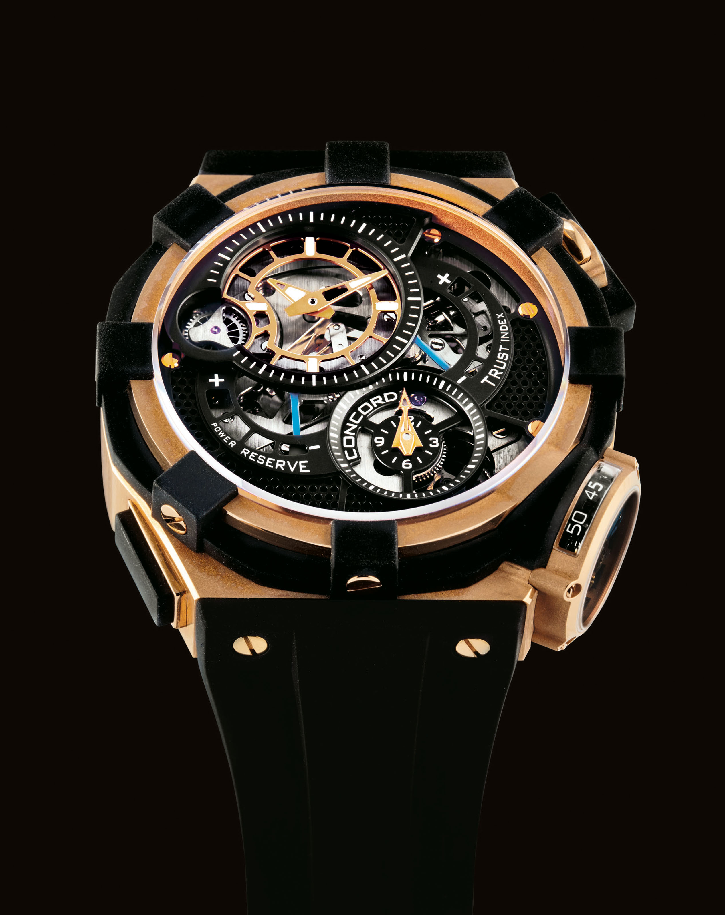 CONCORD. A FINE AND OVERSIZED 18K PINK GOLD AND RUBBER LIMITED EDITION SEMI-SKELETONISED FLYBACK CHRONOGRAPH TOURBILLON WRISTWATCH WITH POWER RESERVE AND TRUST INDEX INDICATIONS