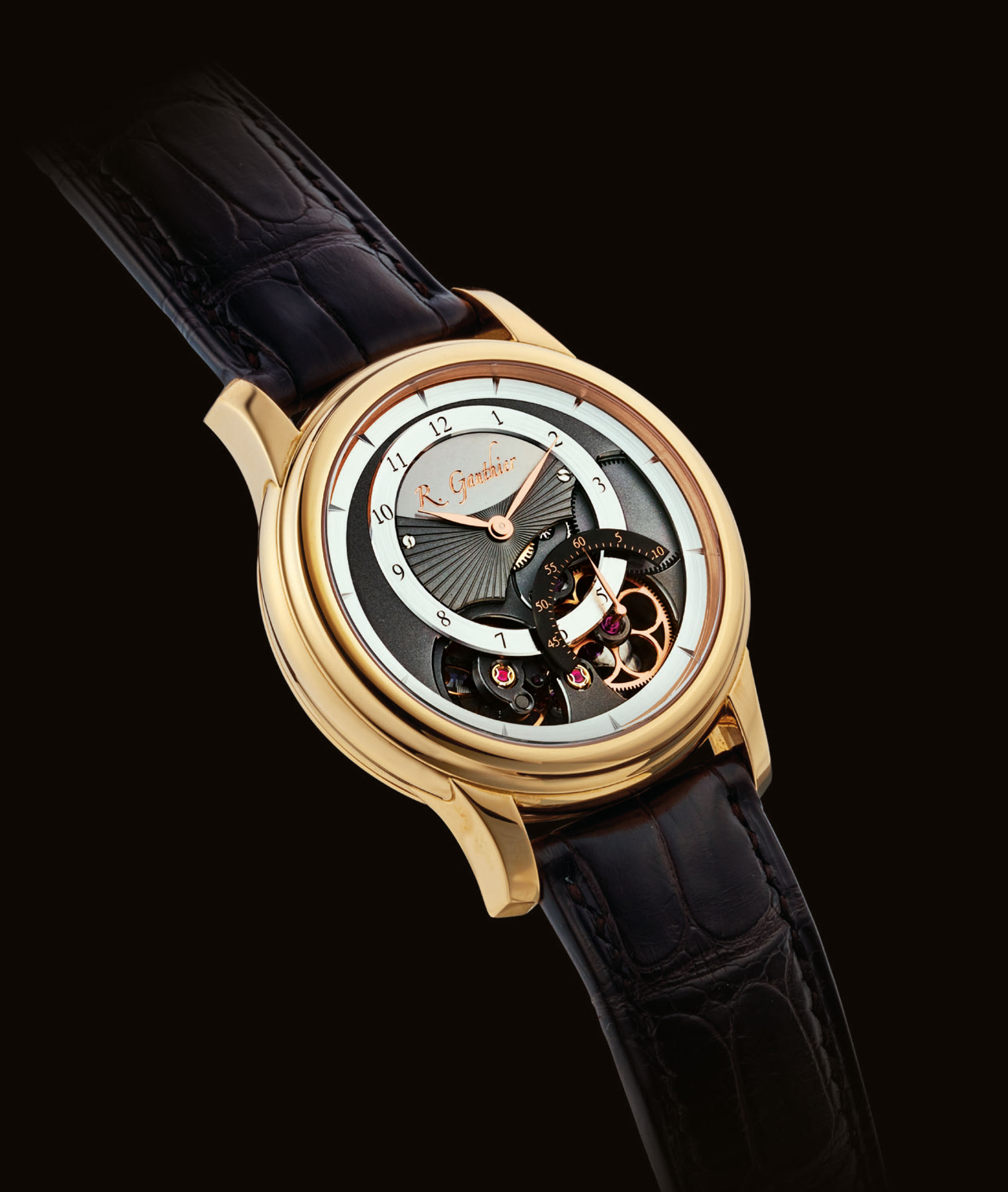ROMAIN GAUTHIER. A VERY FINE AND RARE 18K PINK GOLD SEMI-SKELETONISED WRISTWATCH