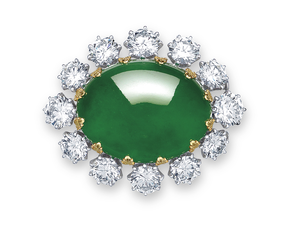 A MAGNIFICENT JADEITE AND DIAMOND PENDANT/BROOCH, MOUNTED BY CARVIN FRENCH