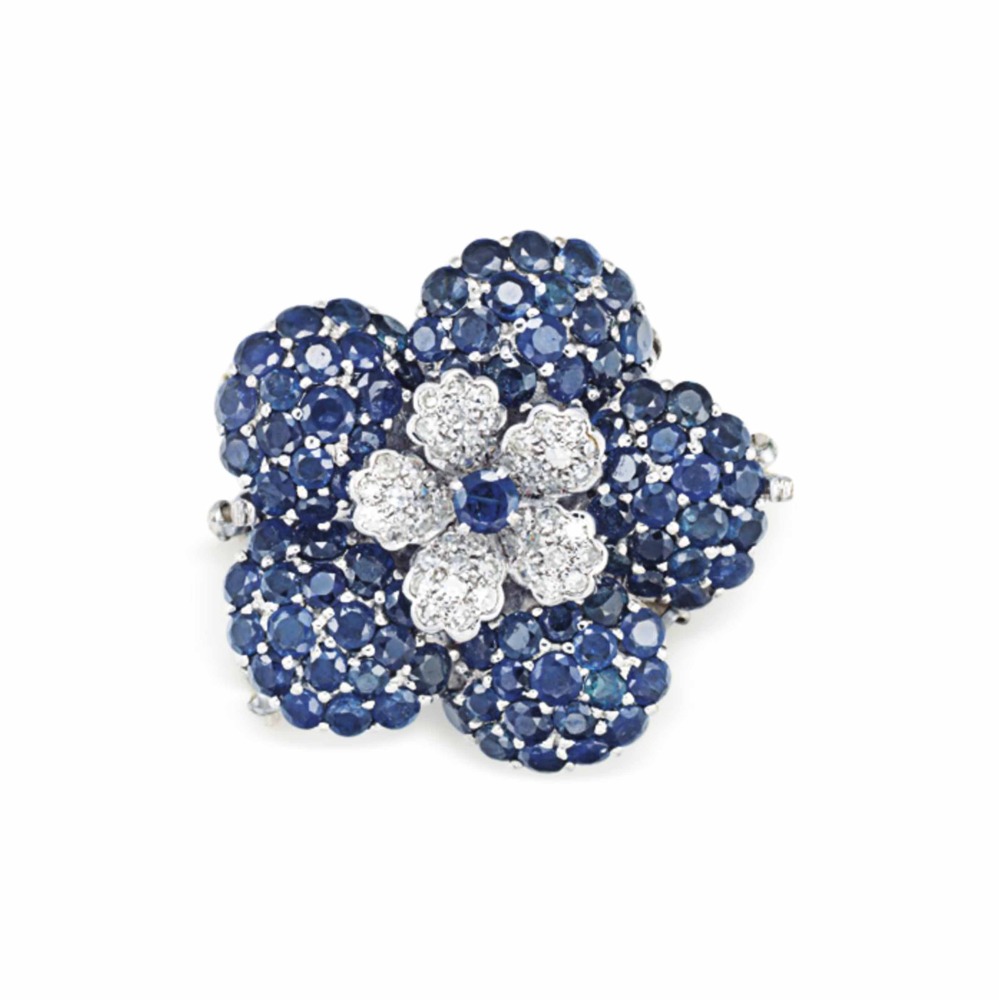 A SAPPHIRE AND DIAMOND FLOWER CLASP, BY TRIO