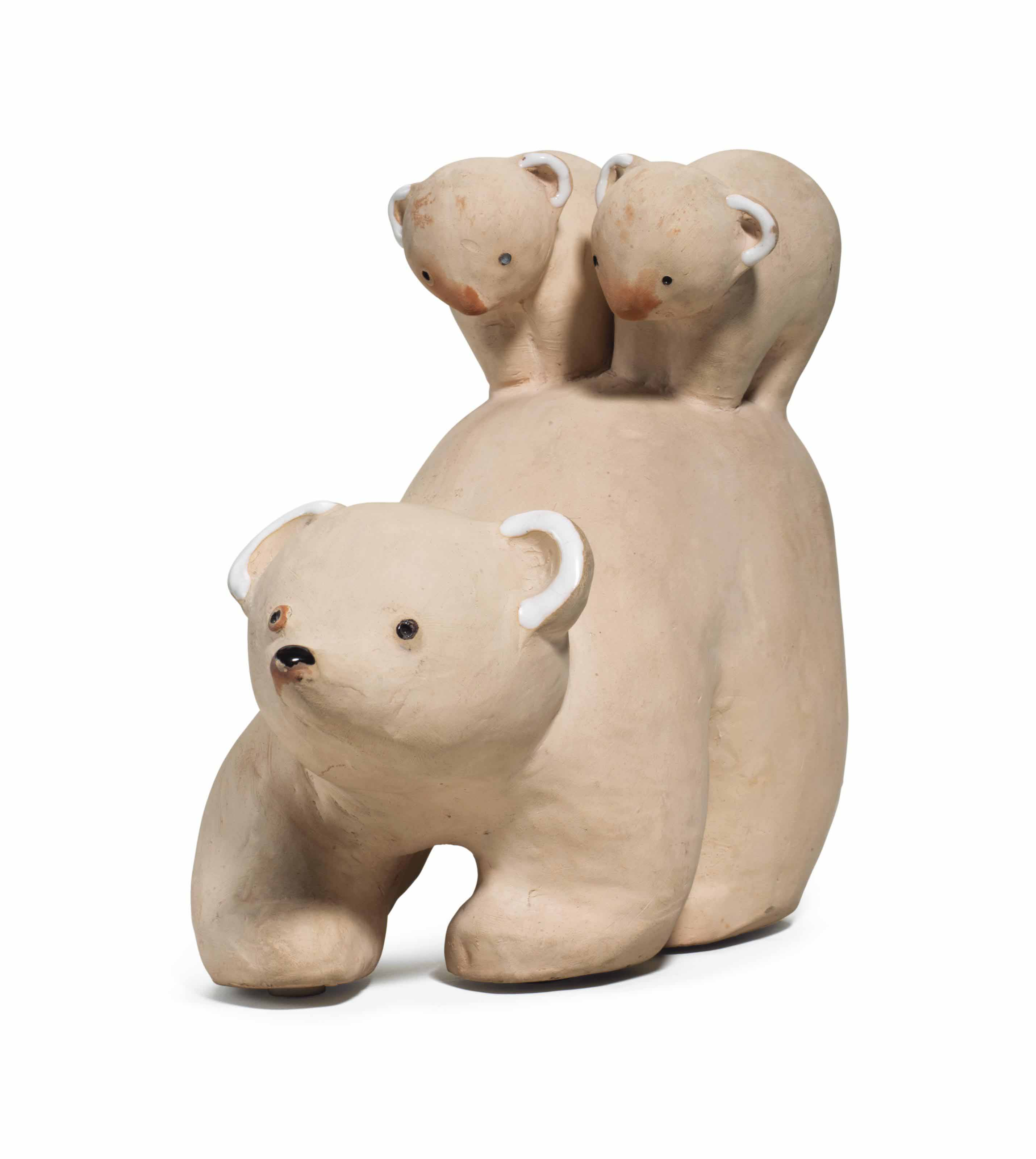 A POTTERY FIGURE OF A BEAR AND TWO CUBS