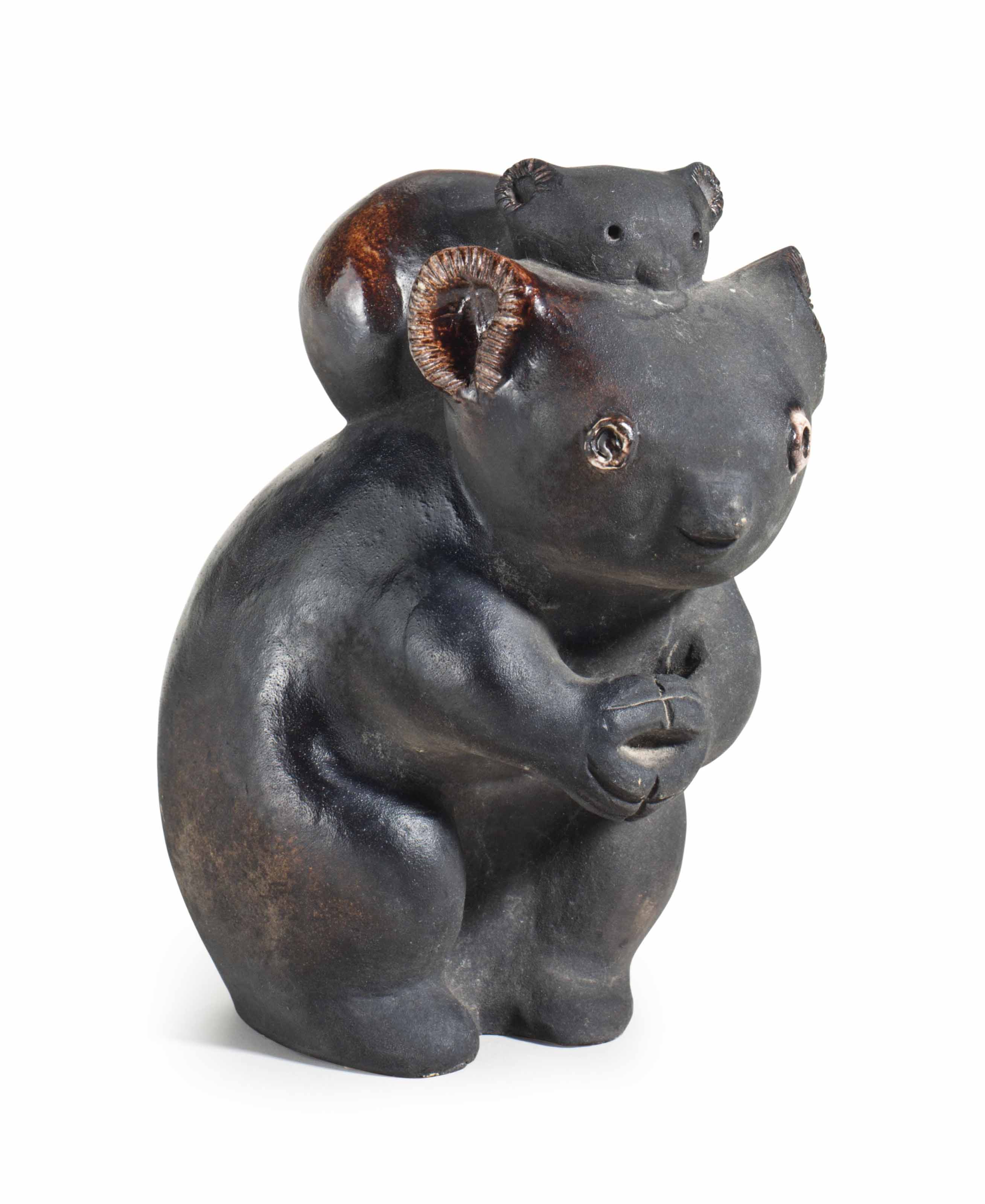 A FRENCH POTTERY FIGURE OF A KOALA AND ITS PUP