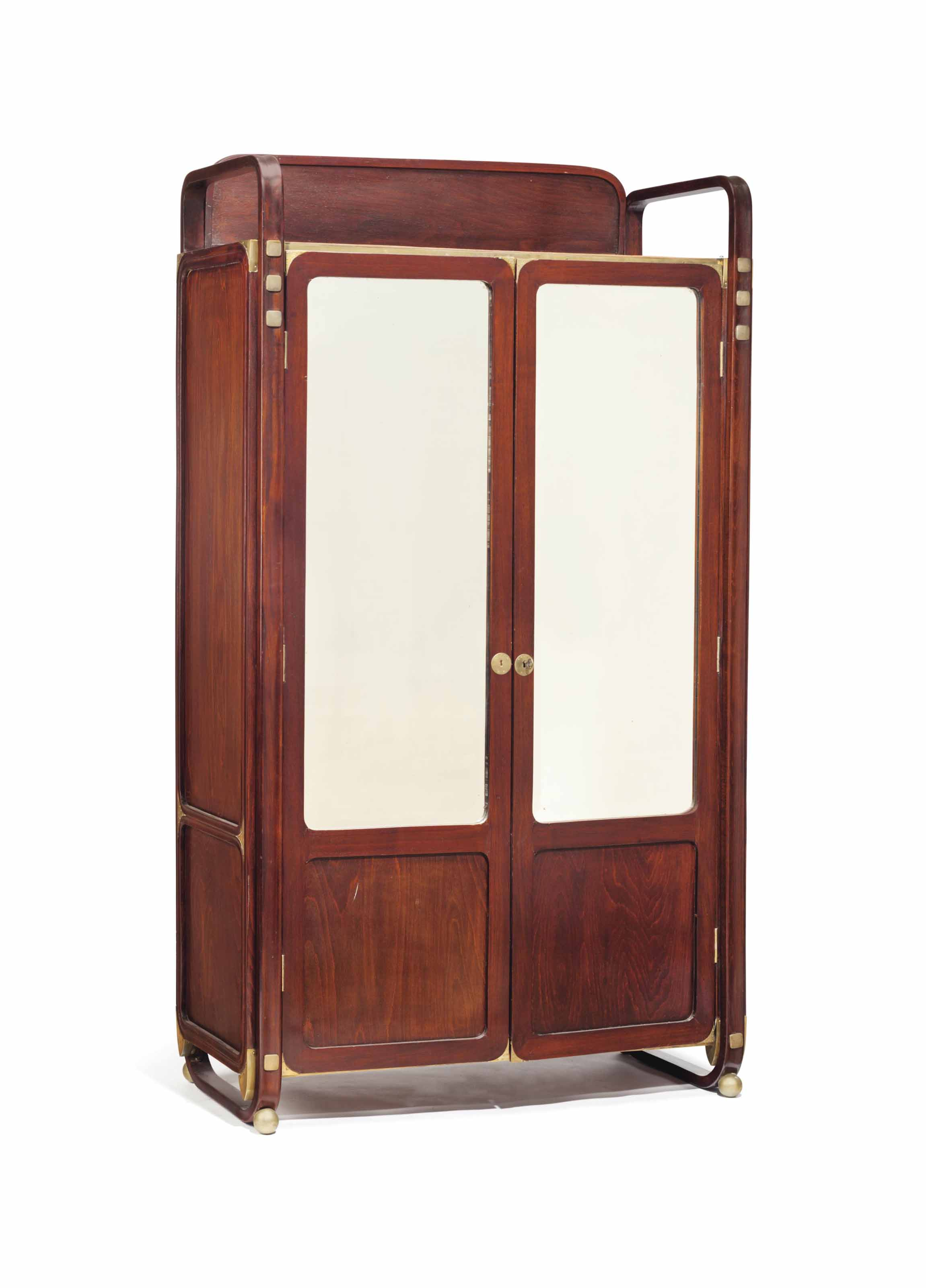 AN AUSTRIAN BRONZE-MOUNTED AND STAINED BEECH ARMOIRE