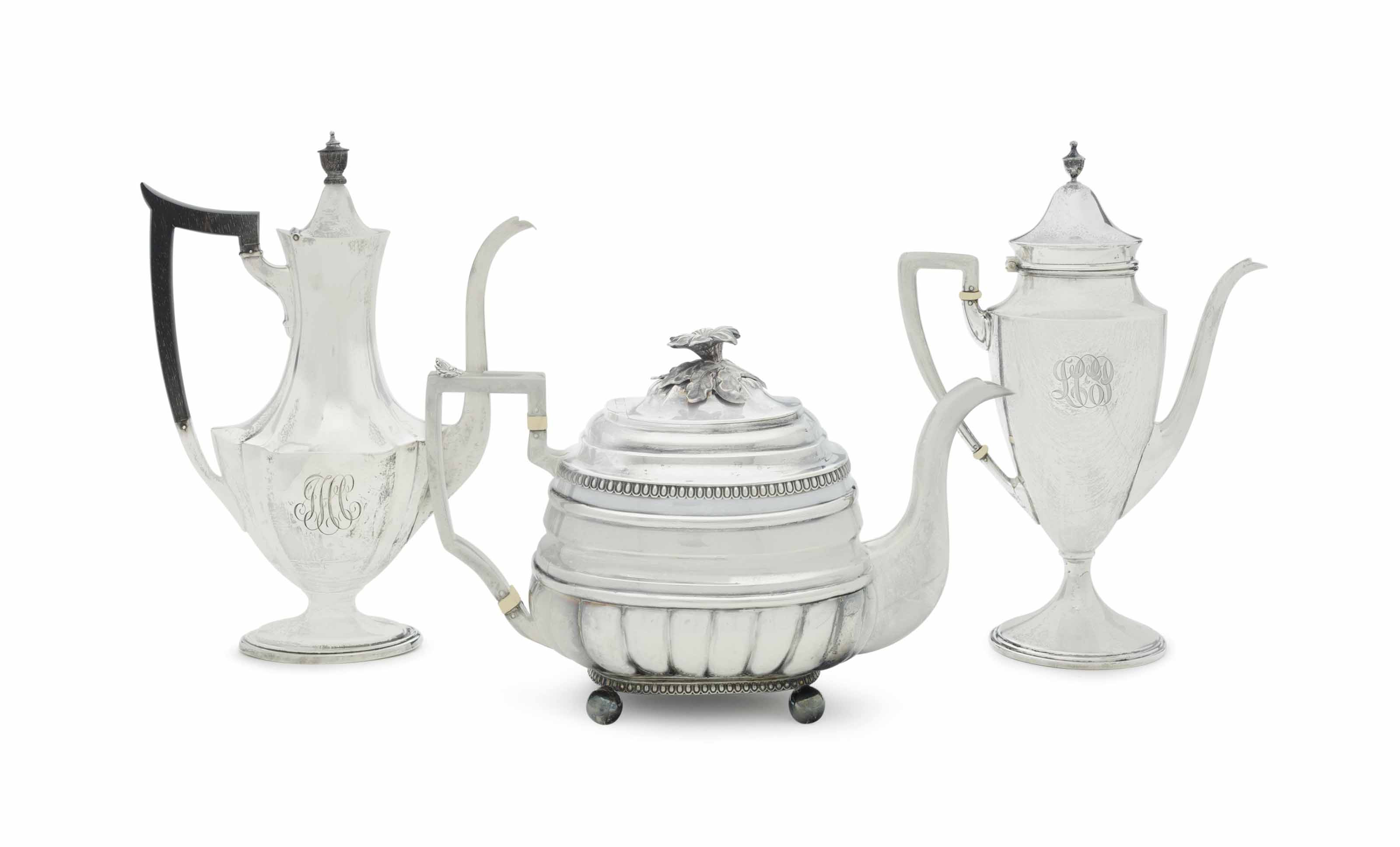 A SCOTTISH SILVER TEAPOT, AND TWO AMERICAN SILVER COFFEE POTS