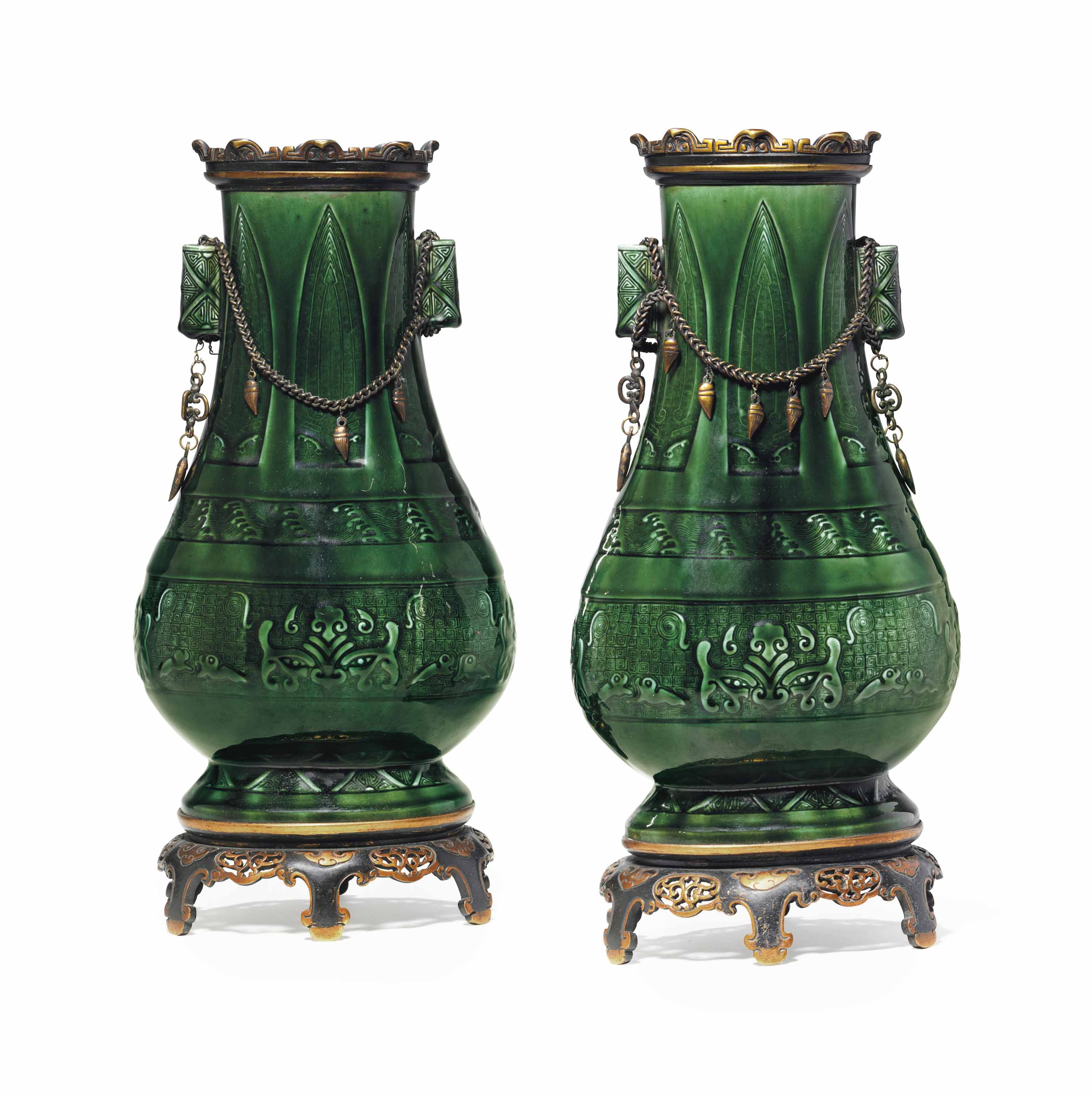 A PAIR OF GILT-METAL MOUNTED THEODORE DECK GREEN-GROUND VASES ON STANDS