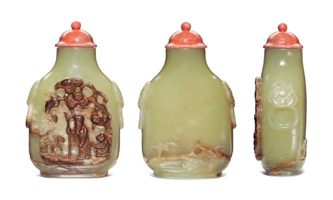 A FINELY CARVED YELLOWISH-GREE