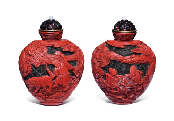 A WELL-CARVED RED AND DARK-GRE