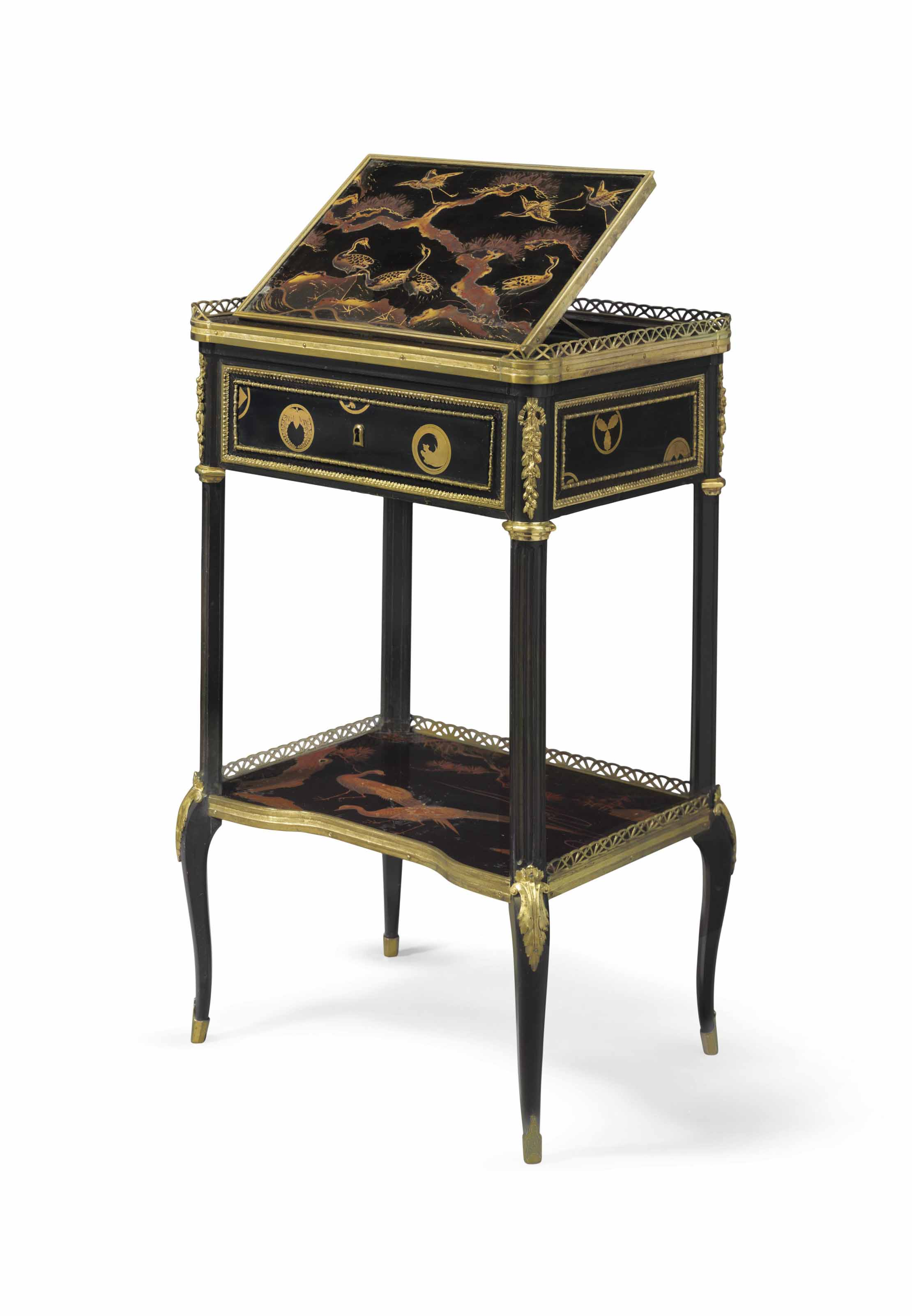 A LOUIS XVI ORMOLU-MOUNTED EBONY AND JAPANESE LACQUER TABLE A PUPITRE