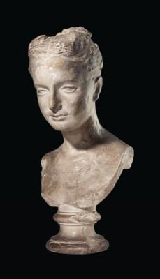 A PLASTER BUST OF A YOUNG GIRL