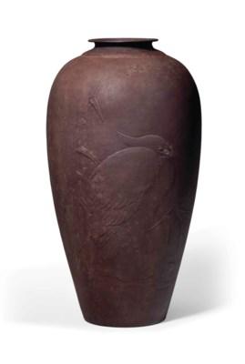 A hammered iron vase