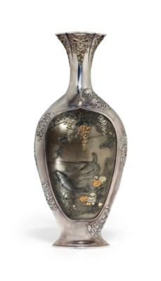 A mixed-metal-inlaid silver va