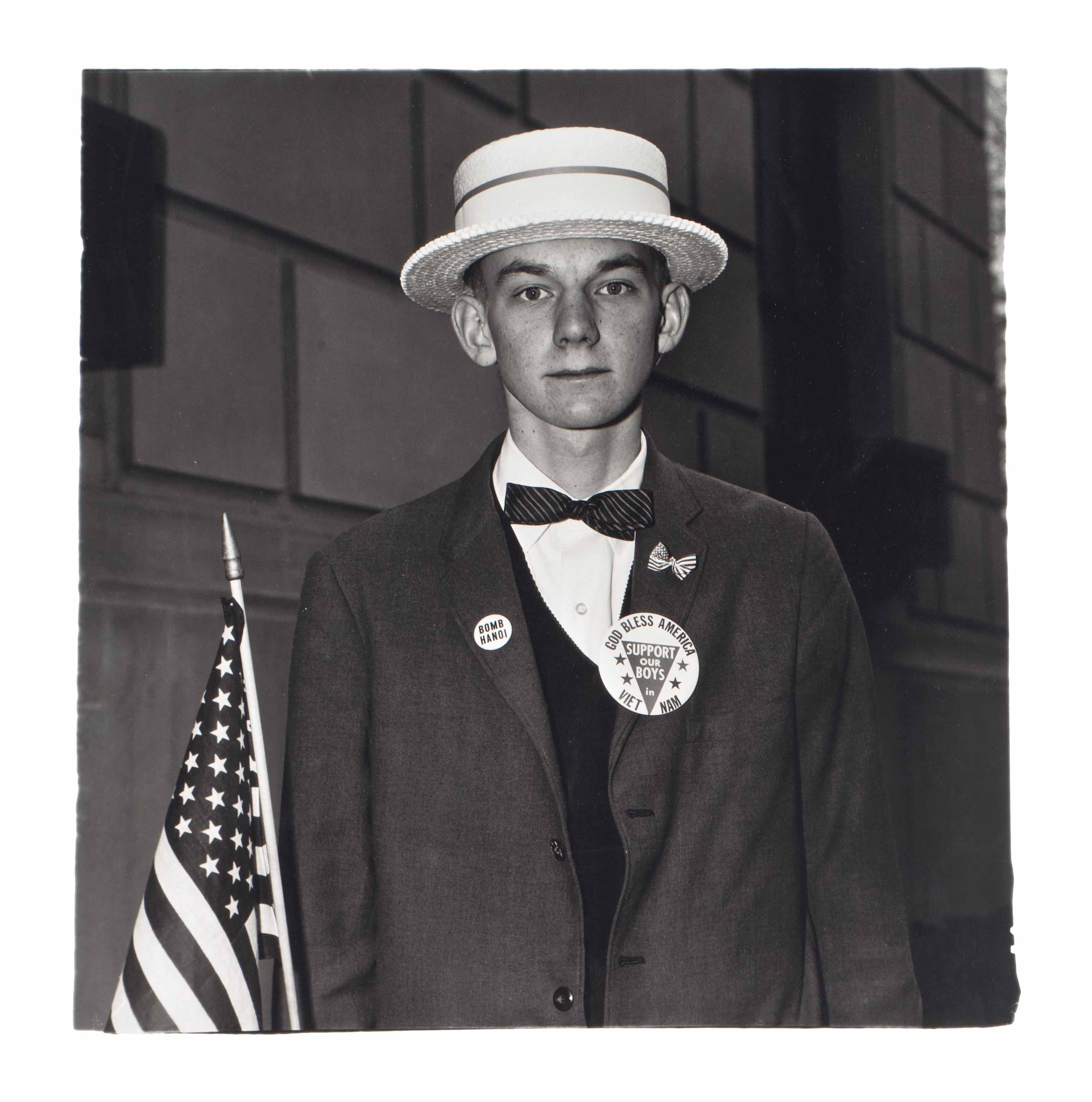 Boy with a straw hat waiting to march in a pro-war parade, N.Y.C., 1967