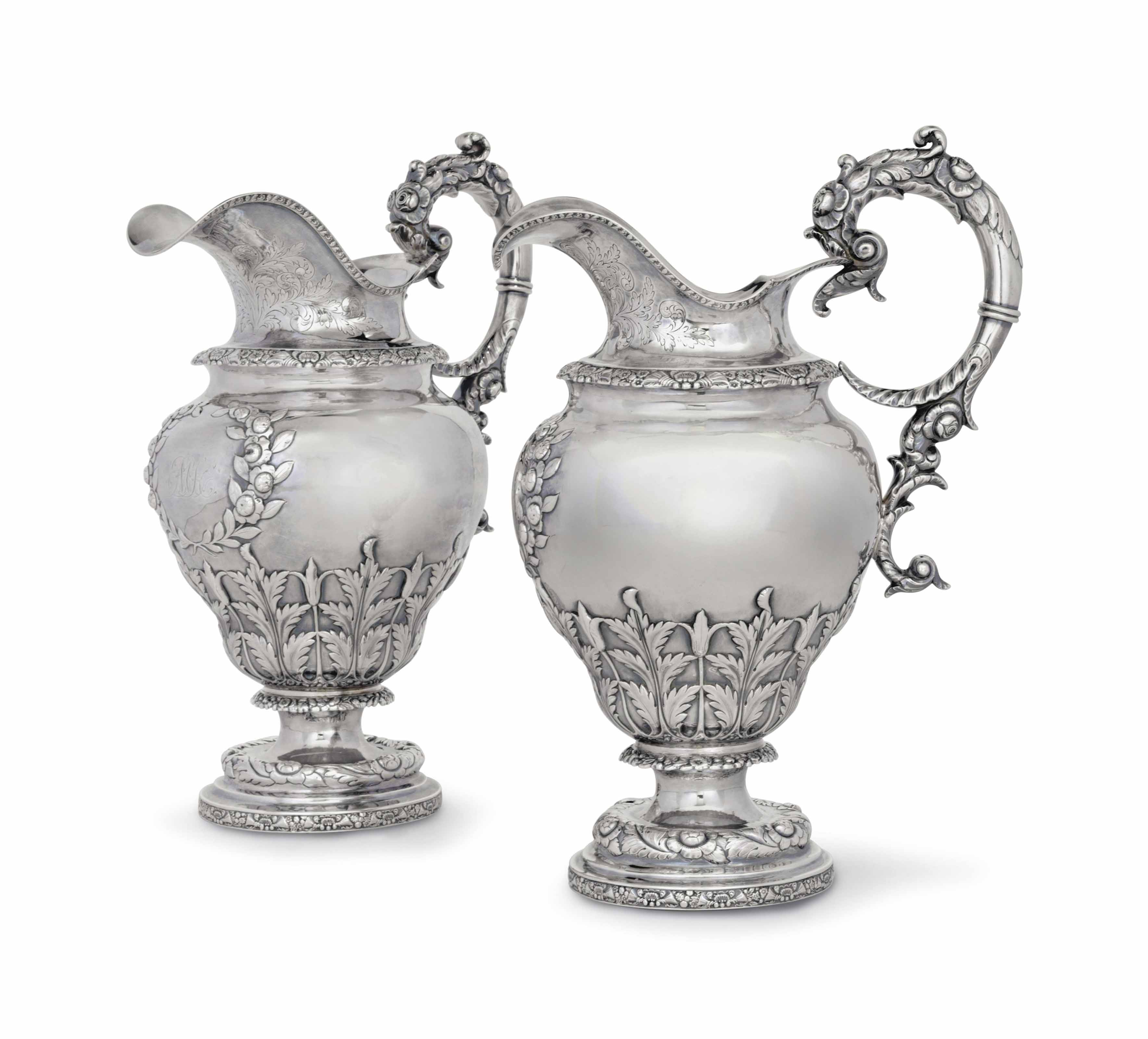 A PAIR OF SILVER WATER PITCHERS